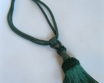 assorted large drapery fancy tassels, different colors, sizes, and prices