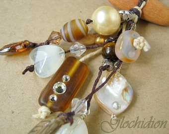 Long cluster style necklace with semi precious, Swarovski Crystalized elements, wood, glass and shell