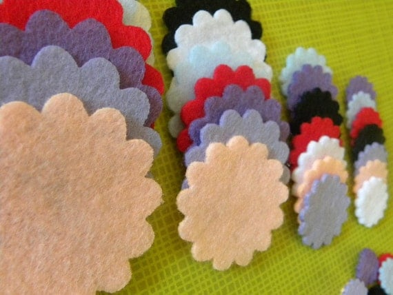 F104 ---- 21 Felt  flowers scalloped 7 colors and 3 sizes