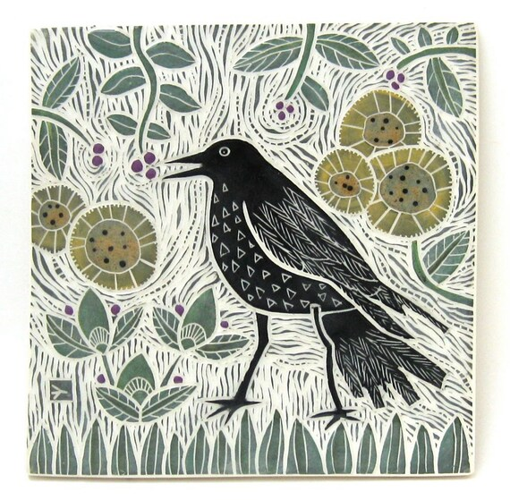 hand carved ceramic art tile crow in garden