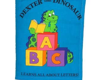 SOFT / CLOTH BOOK - Dexter the Dinosaur Learns Letters