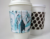 Reusable Reversible Coffee Sleeve - Teal Cityscape with brown polka dots