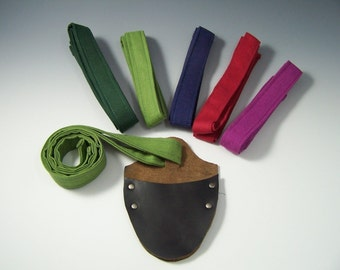 One Leather Sheath and Strap