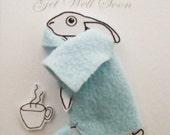 Baby Hare in a Blue Fleece Blanket with Mug of Hot Orange Get Well Soon Handmade Card