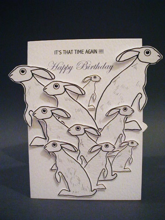 Its That Time Again  Happy Birthday Handmade Card in White with lots and lots of Grey Hares  - can fit a max of 65 hares on - thats old eh