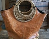 Vintage orangey brown leather bag made in India,wooden and straw handle,one button to close
