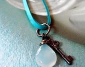 Soft blue chalcedony drop on deerskin leather