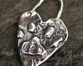 Paw Print Heart Charm in Sterling Silver