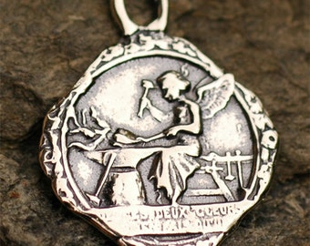 Angel at the Forge hammering Sacred and Immaculate Heart Together Charm in Sterling Silver, 128s