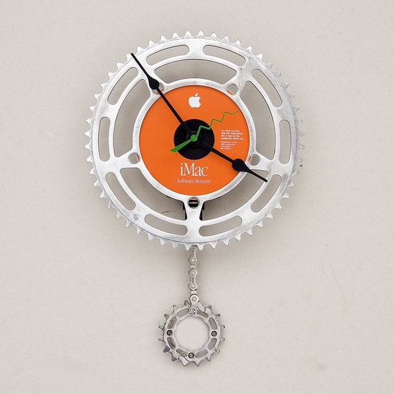 Clock made from a recycled Bike Chain ring and an Apple imac CD restore disk