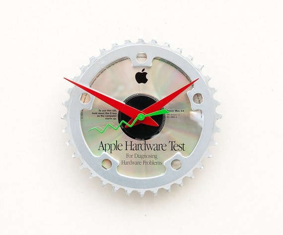 Clock made from a recycled Bike Chain ring and an Apple Hardware Test CD