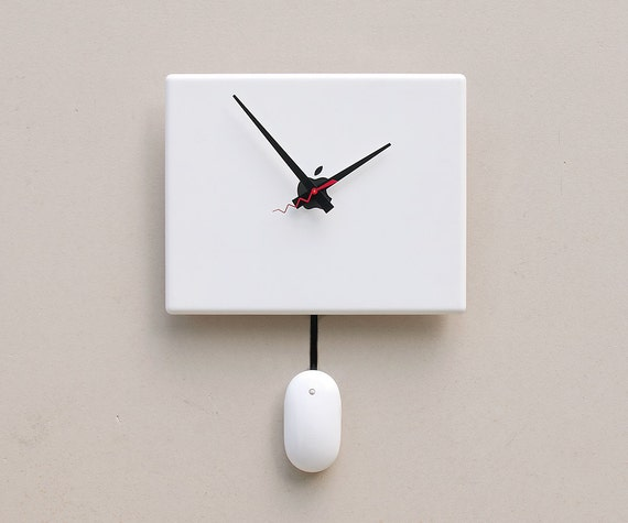 Clock created from a recycled Apple ibook laptop cover