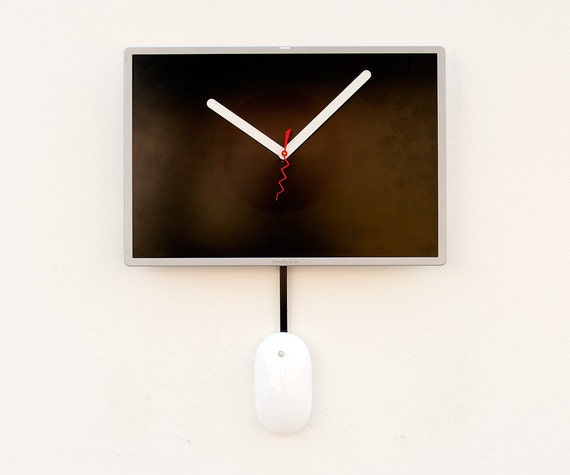 Clock created from a recycled Apple Powerbook G4 laptop  LCD screen