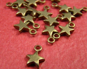 50% OFF SALE - 40pcs 10mm Antique Raw Brass Star Charm CWD303
