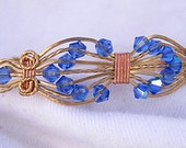 ON SALE - Blue AB Bicone Czech Beads in Bronze and Copper Wire Wrapped Bracelet