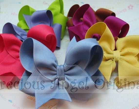 You choose a Set of 6 Custom 4 inch  Boutique Bows  Over 100 colors available