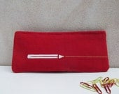 Red pencil case with yellow line