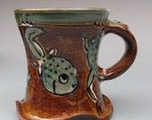 Mug with Tadpoles stoneware pottery amber glaze