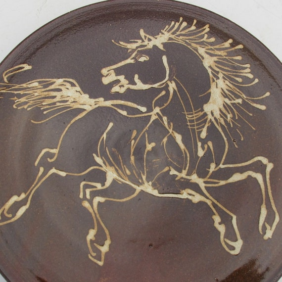 Plate with  horse dark amber with white slip trail