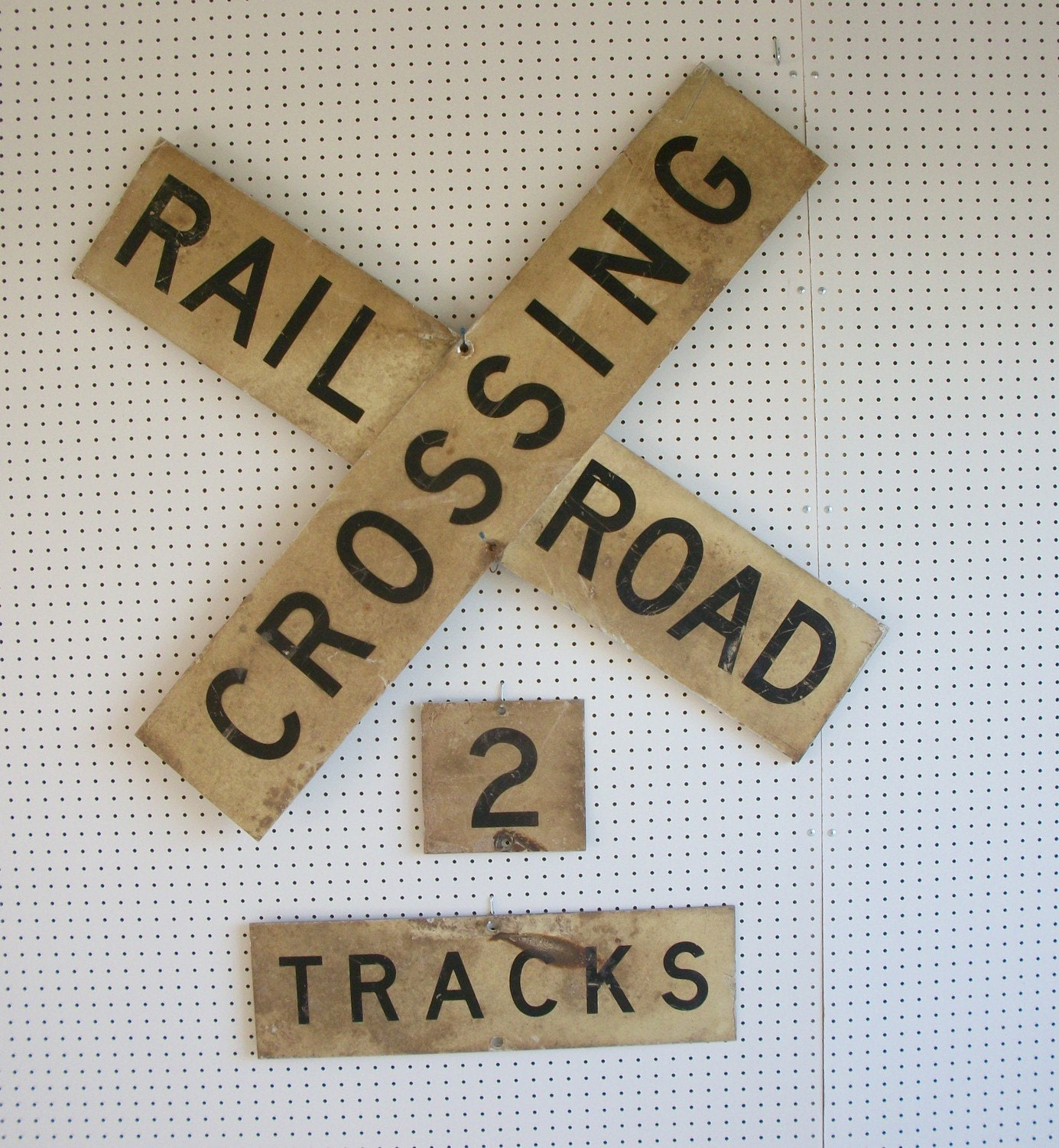 vintage crossbuck railroad crossing sign with track signs