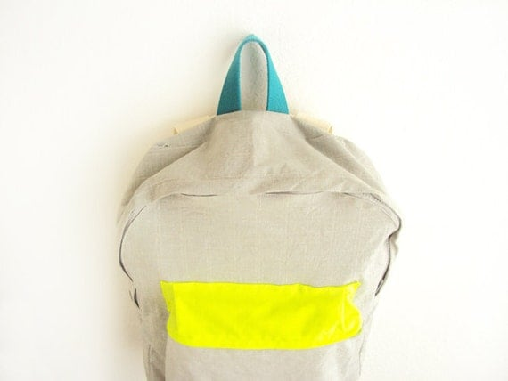 Light grey with thin stripes backpack with neon yellow pouch