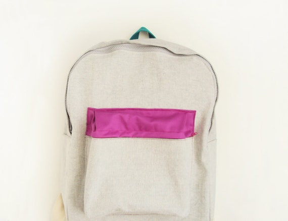 light grey denim backpack with magenta pouch