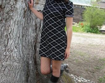 little 70s black dress that rocks size 8