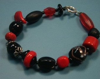 Lovely unique one-of-a-kind clear red and black bracelet made of vintage1960s handblown glass beads