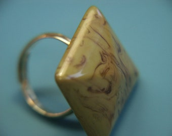 Adjustable silvercolor ring with genuine tested slightly swirled vintage 1950s olive green square bakelite plastic bead