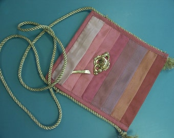 Lovely  small party-purse of cotton fabric textile in matching pink colors with antique brooch decoration