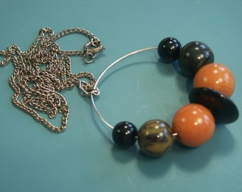 Unique one-of-a-kind chain necklace with round vintage 1940s genuin tested bakelite bead pendant