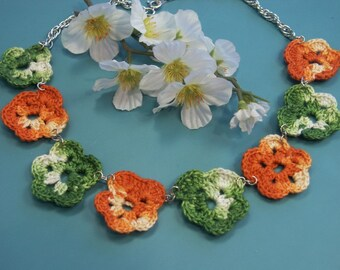 Unique one-of-a-kind necklace of marbled orange and green chrocheted cotton yarn violet flowers