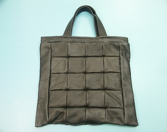 Very useful small highquality new/unused tote bag/handbag of strong real natural organic black skin/leather