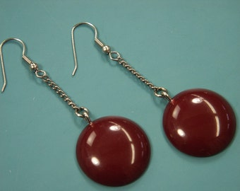 Pair of earhangings made of opaque vintage 1940s tested dark cherry red bakelite plastic cabuchons and silvercolor chains and earhooks
