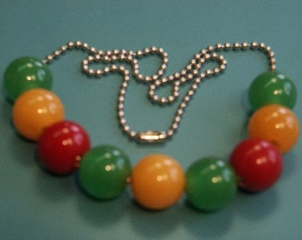 Unusual necklaceof silvercolor metal ball chain and 9 green/ yellow/ red 15 mms genuin tested bakelite beads