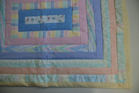 Lovely mild pastel color quilt babycover of prewashed cotton textile in log cabin pattern