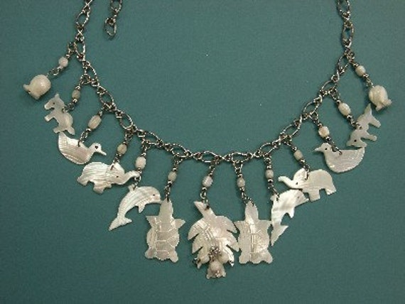 Unique one-of-a-kind necklace with 13 vintage 1970s handmade carwqed/ cut mother of pearl animal charms/ pendants