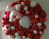 Nothin' says I Heart You like a festive red and pink Valentine's yarn ball wreath