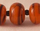 Tangerine and Black Cyclone Lampwork Beads