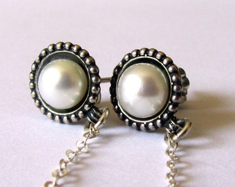 Sterling Silver Earrings set with Pearls