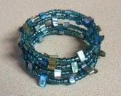Teal shell bead memory wire bracelet