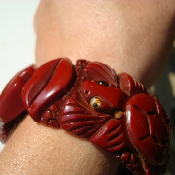 Heavily Carved Vintage Root Beer Bakelite Style Clamper Bracelet with Wiggle-eyed Turtles and Kissing Lips