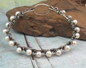 MOON DROPS white freshwater pearl and sterling silver bangle by Crazy Daisy Designs