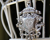 monogrammed family CREST in solid sterling silver