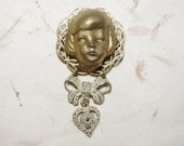 Gilded Frozen Charlotte Head Filigree Brooch with Bow