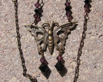Brass Filigree Butterfly Pendant Necklace with Purple and Black Swarovski