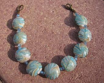 Aqua Swirl Bracelet with Foil Lentil Beads