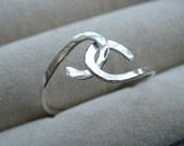 intertwined, just for you, a ring of sterling silver, handmade in your size
