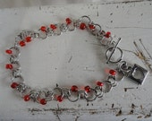 Bracelet with red Glass Beads and Heart Charm