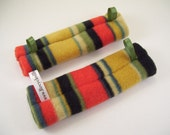Earth Stripes in red, blue, olive, black, ivory and gold CPAP Strap cushions